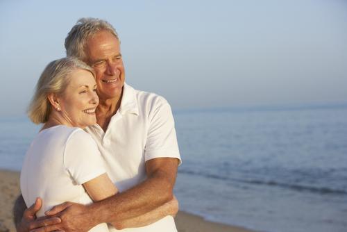 Elderly couple enjoying the sunset after Glaucoma Surgery