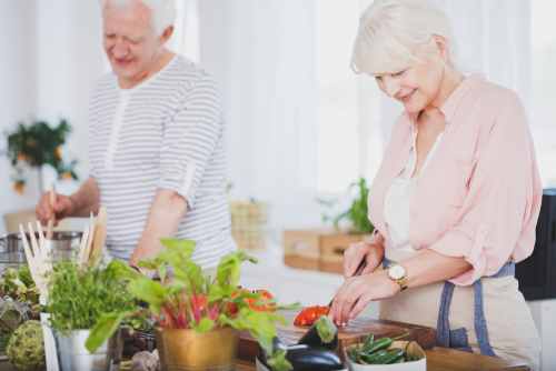 Older couple cooking after glaucoma surgery